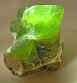 Description: A bright green crystal of peridot